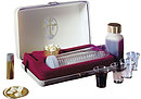 Portable Comm Set Delux 4 Cup with Oil Stock.20-Disposable cups with built-in holders for serving. Leak-proof bottle.  Elegant gold-leaf cross inside lid. 4 1/4in x 7in  x 2 in